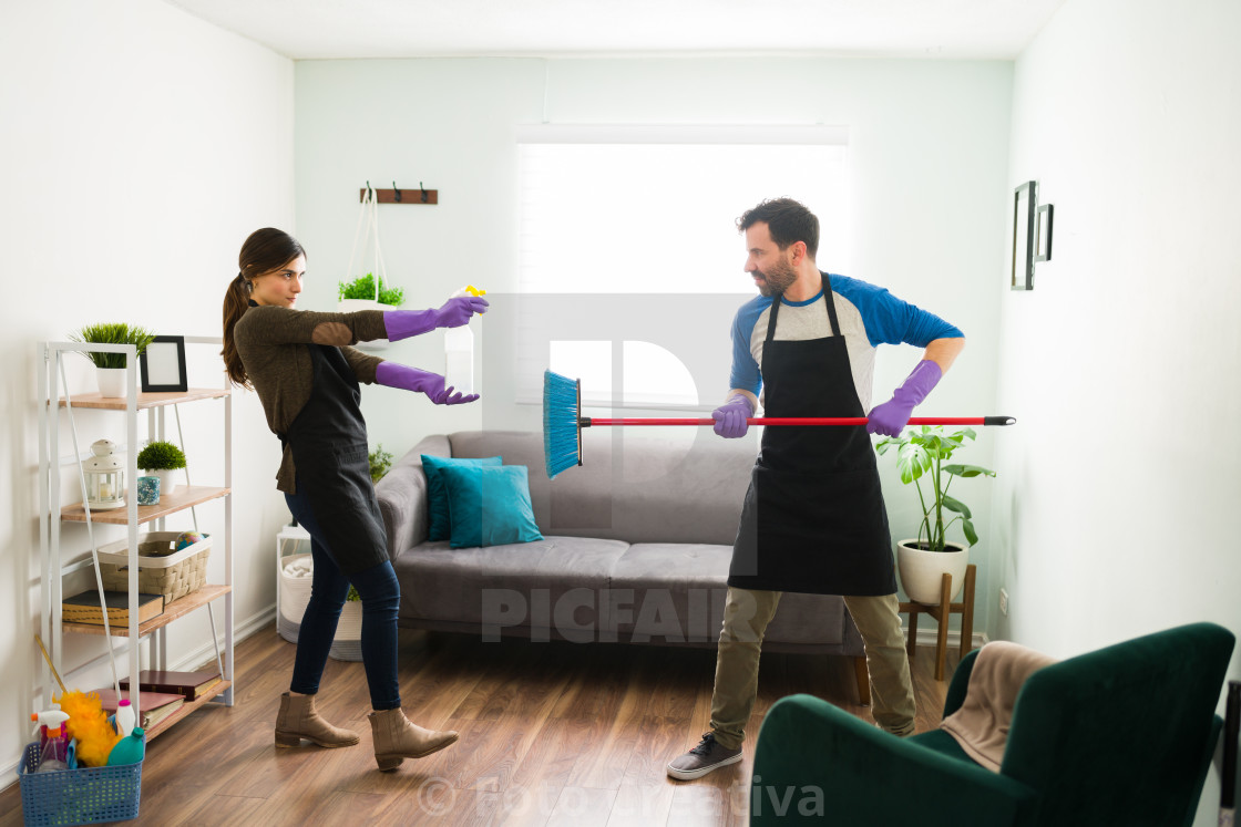 """Couple having fun with cleaning products"" stock image"