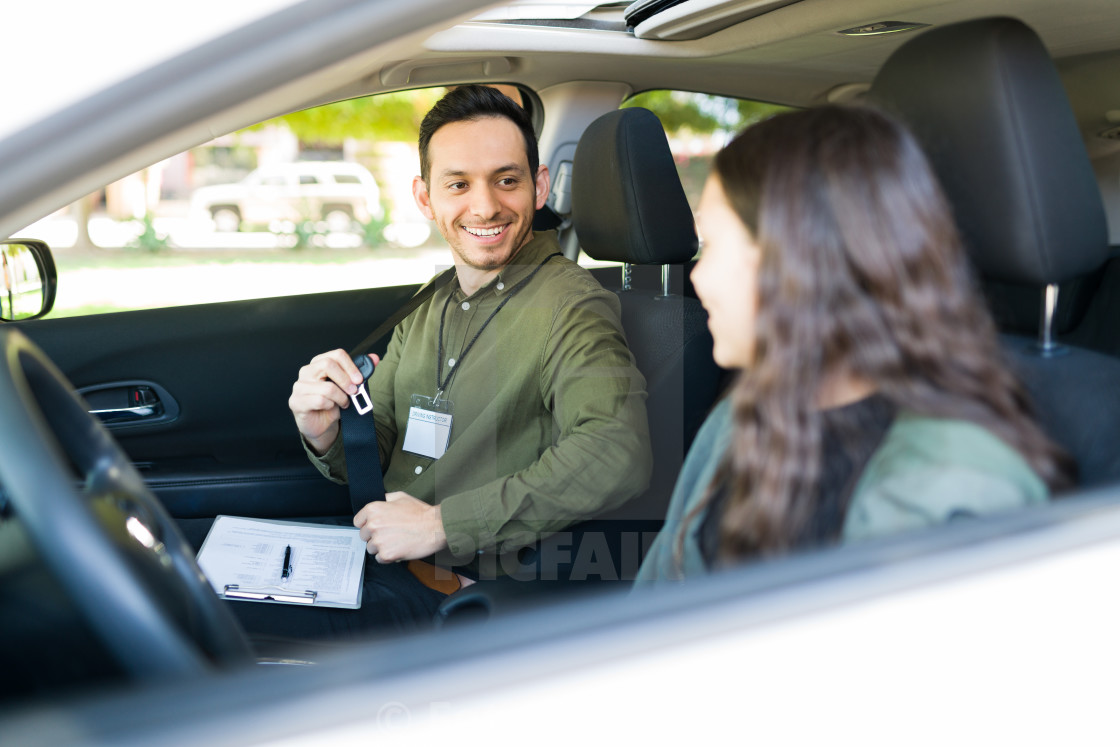 """Driving school instructor working with a teen girl"" stock image"