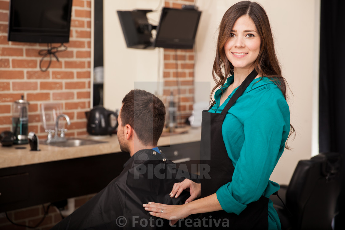 """Cute lady barber at work"" stock image"