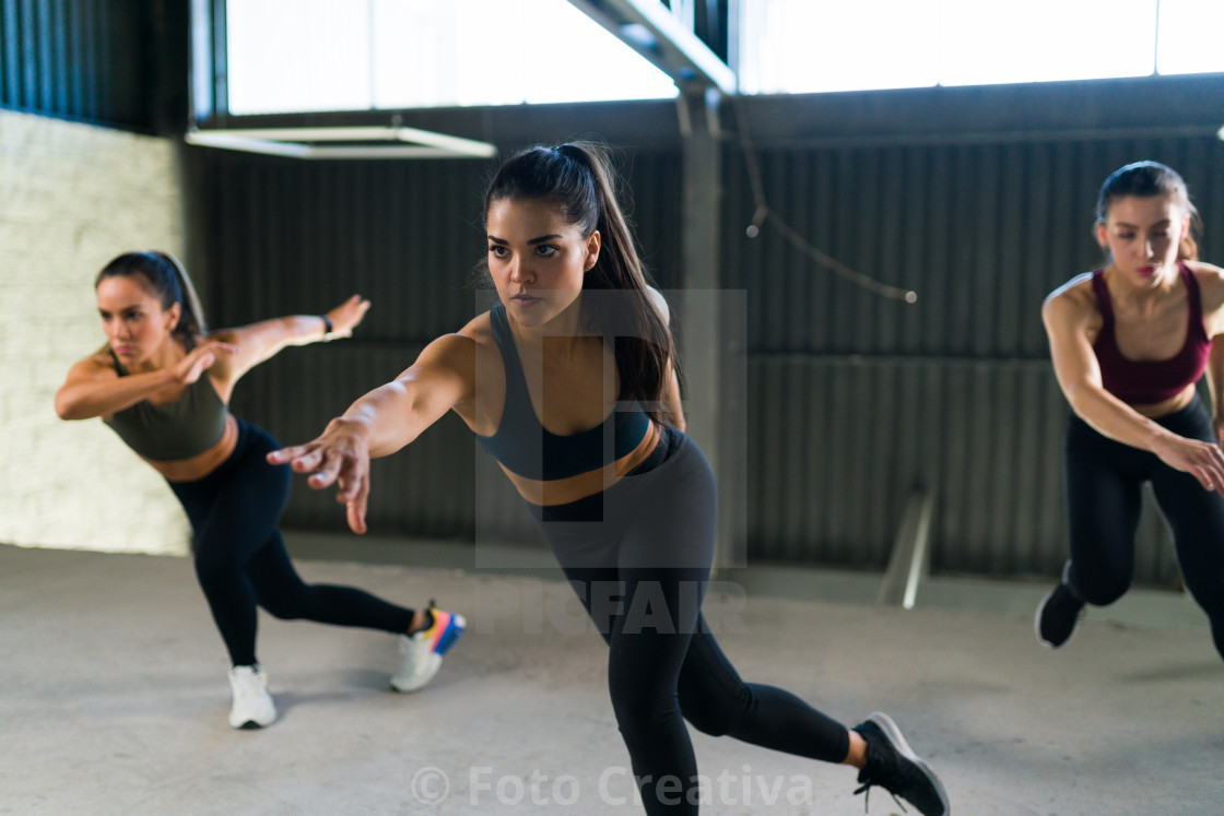 """Three women doing a workout exercises indoors"" stock image"