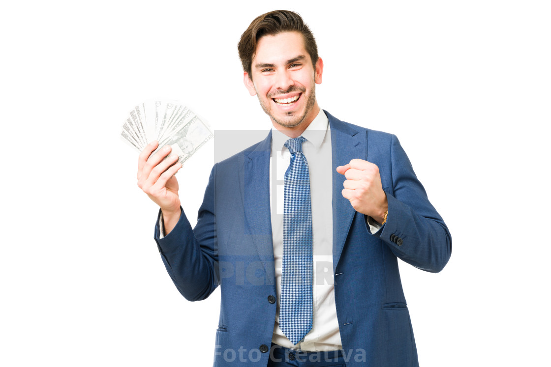 """Portrait of a professional man celebrating with cash"" stock image"