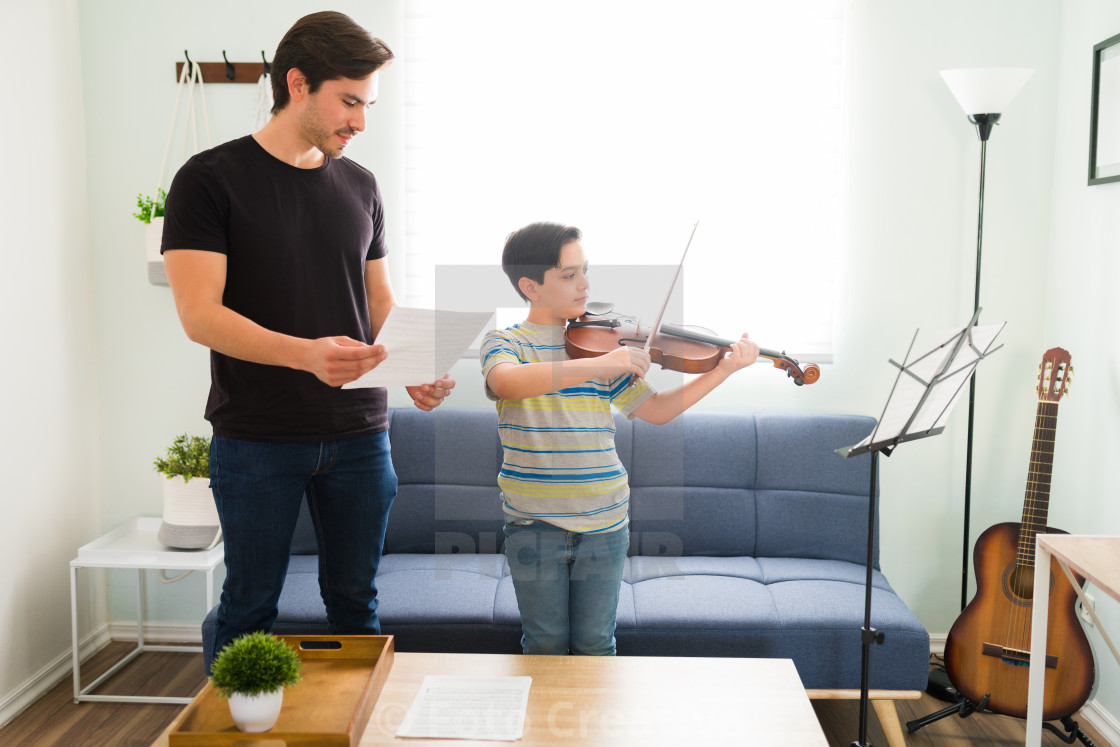 """""""Young student showing his musical skills"""" stock image"""