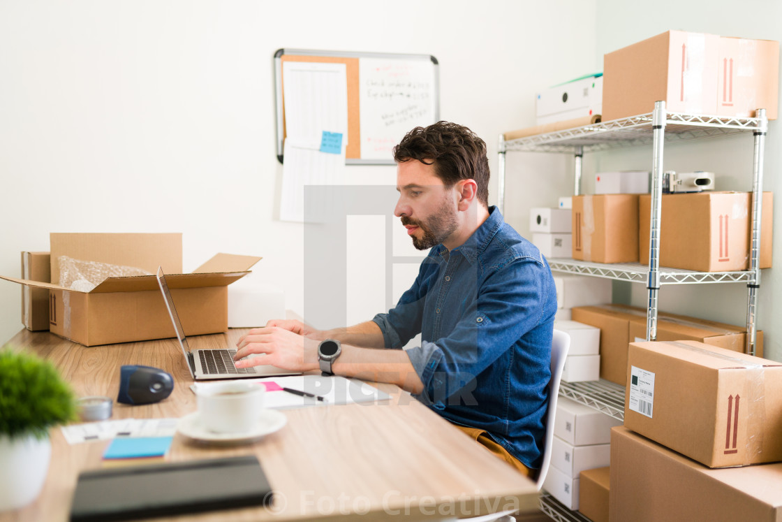 """""""Business owner making a sales report at work"""" stock image"""