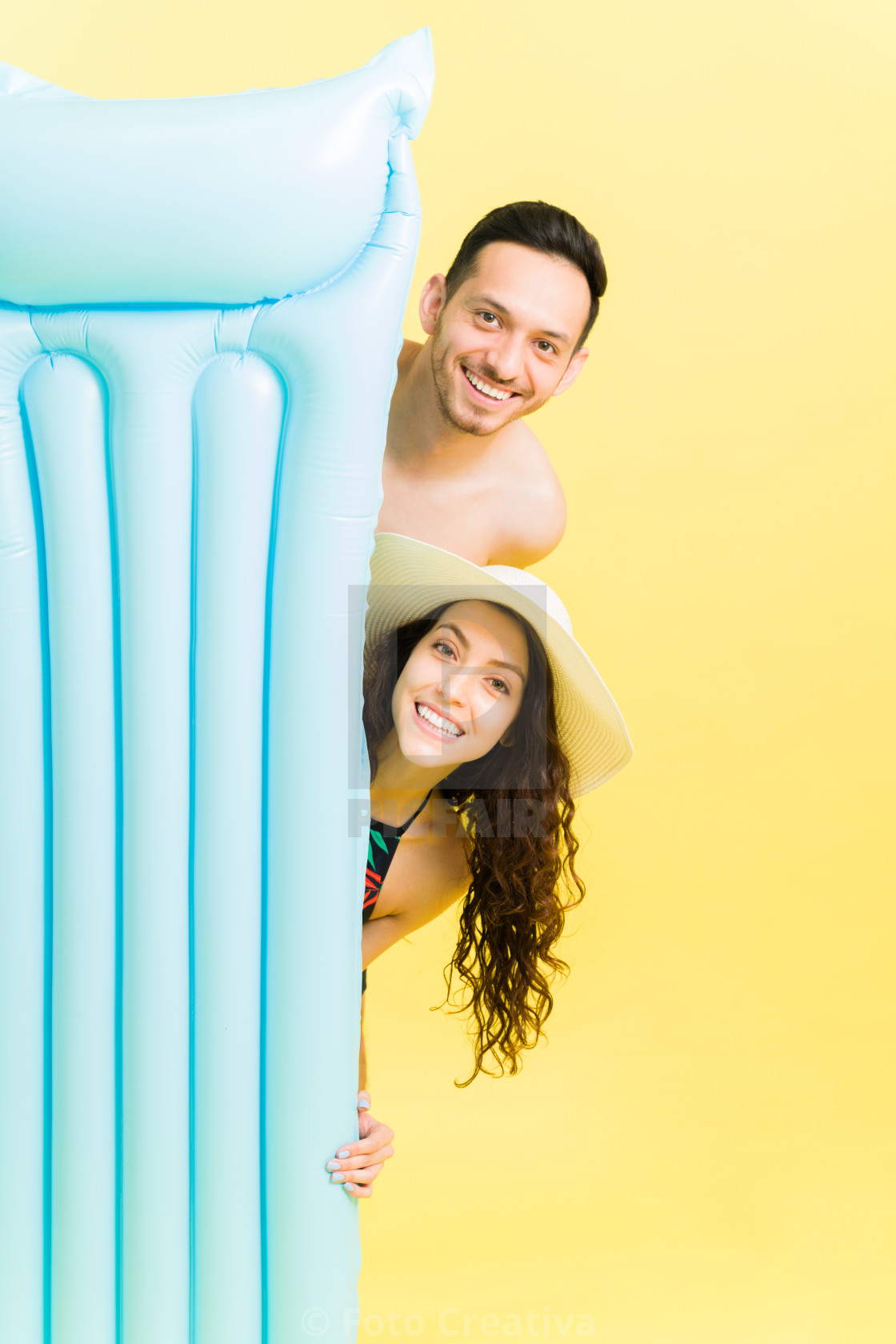"""""""Relaxed boyfriend and girlfriend by the pool"""" stock image"""