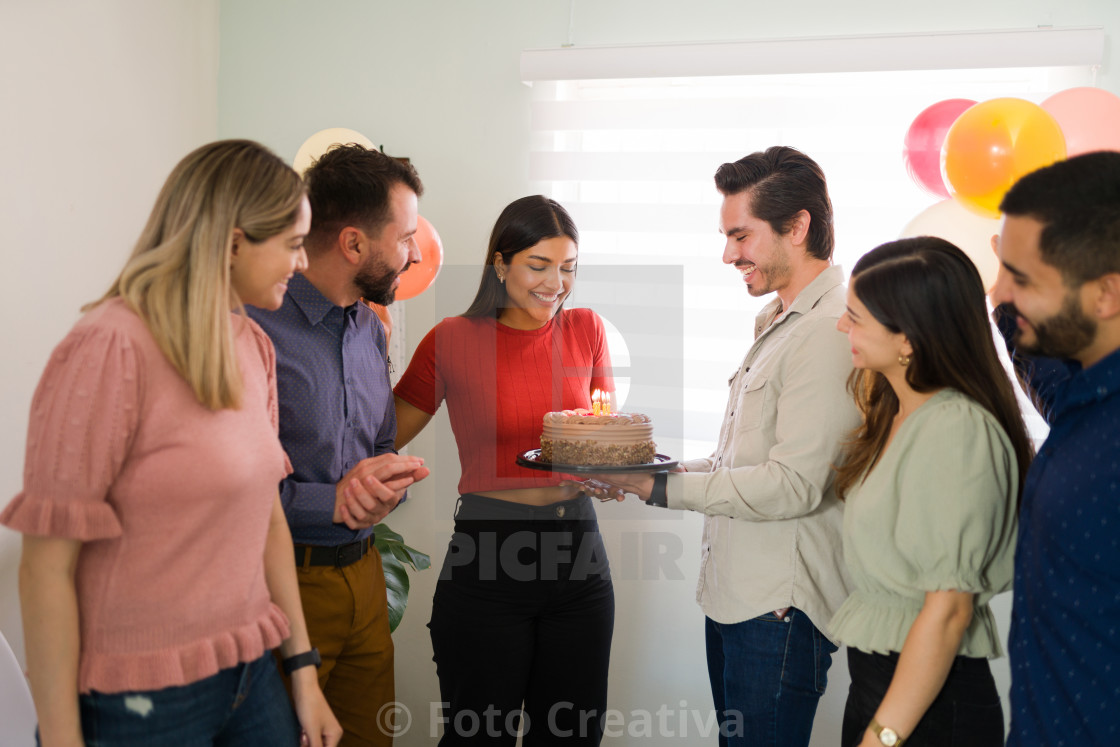 """""""Surprise! Diverse people throwing a party"""" stock image"""