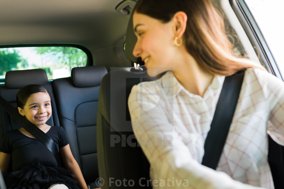 """""""Attractive woman driving her kid to class"""" stock image"""