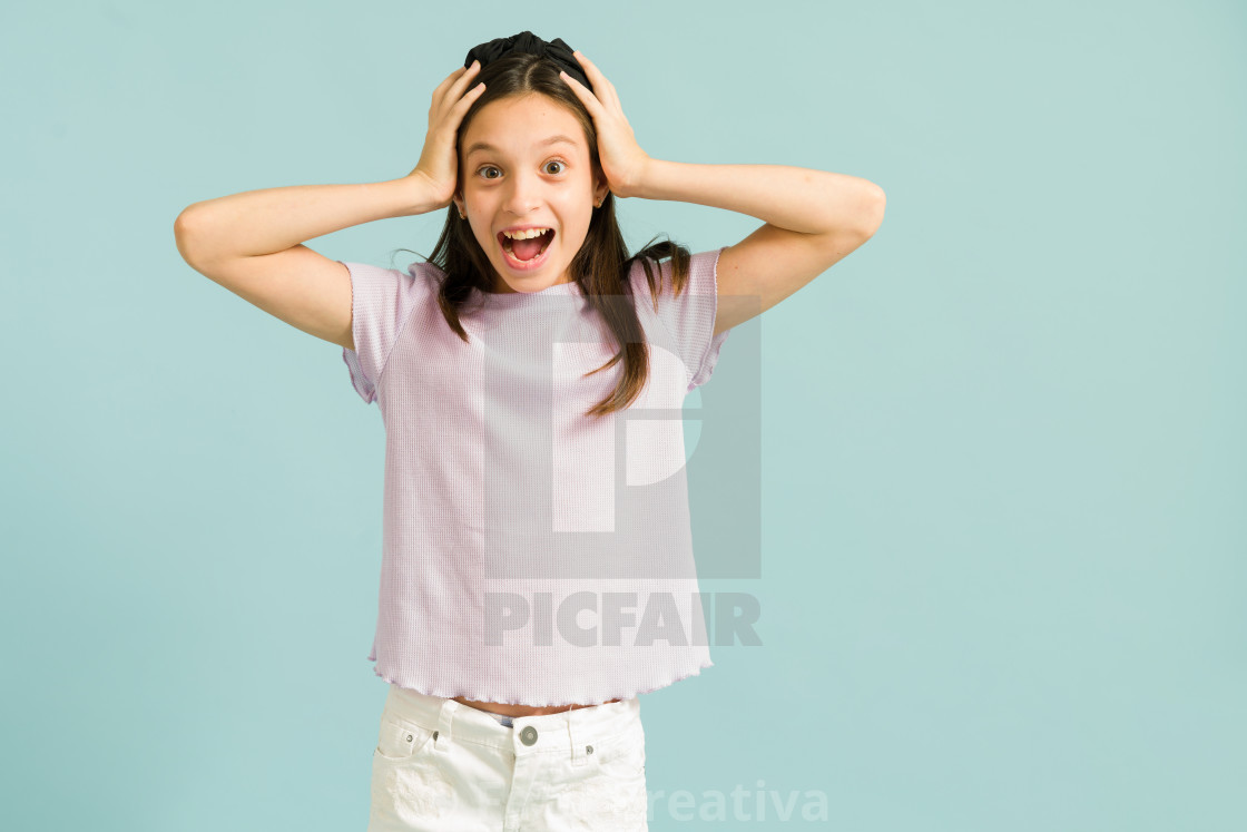 """""""Young girl smiling and feeling very excited"""" stock image"""