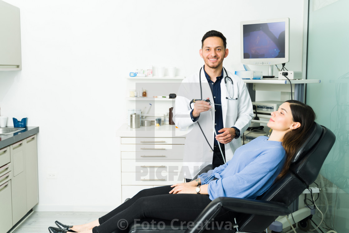 """""""Portrait of a physician with a patient at his office"""" stock image"""