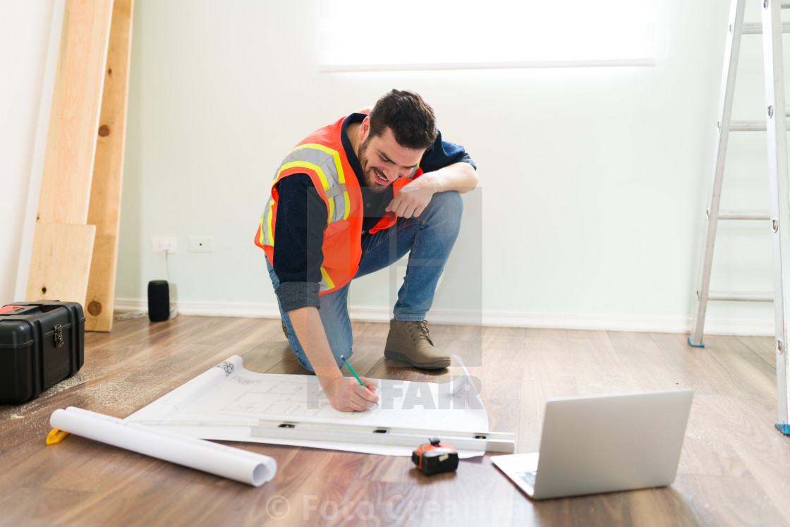 """""""Happy contractor checking the blueprints"""" stock image"""