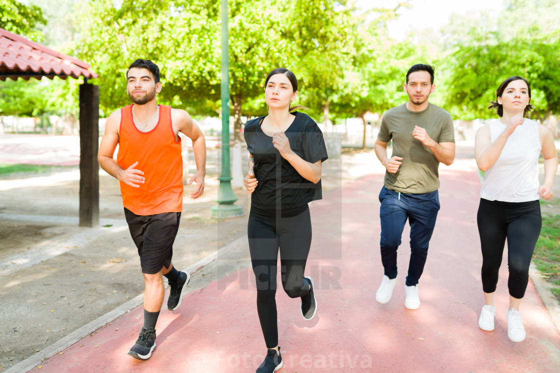 """""""Group of friends in activewear jogging"""" stock image"""