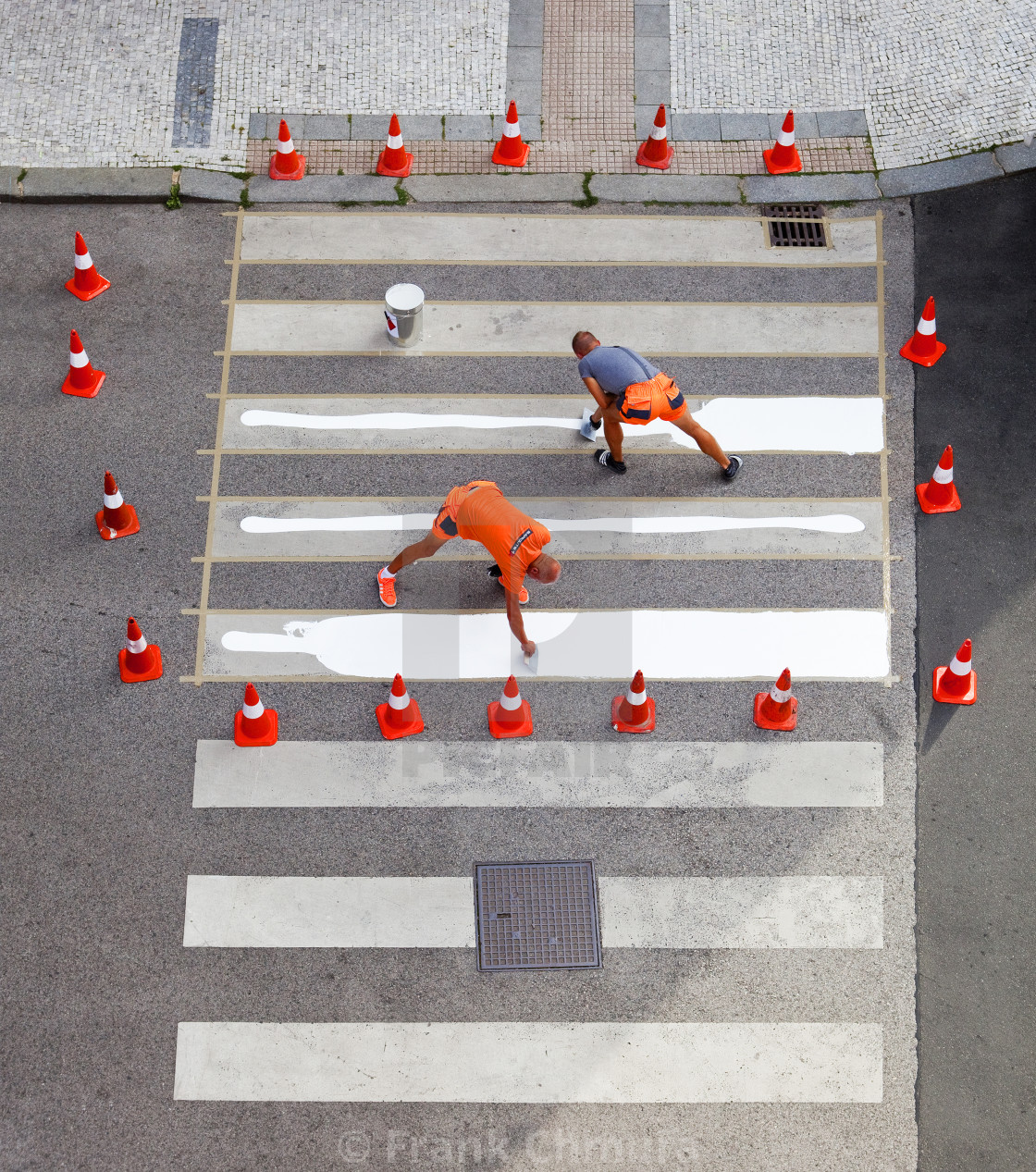 """""""Workers painting crosswalk stripes with white colour."""" stock image"""