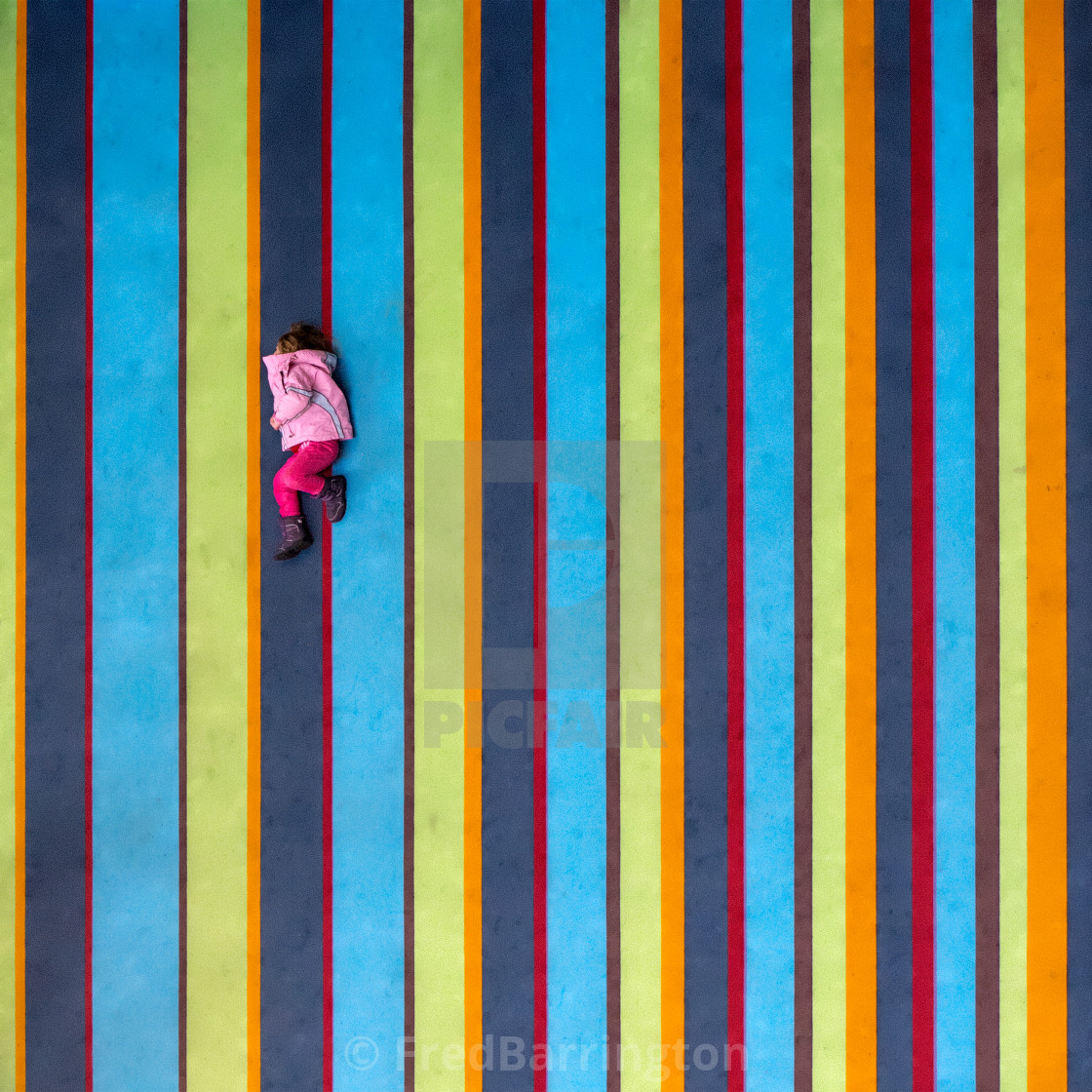 """Child among the Stripes"" stock image"