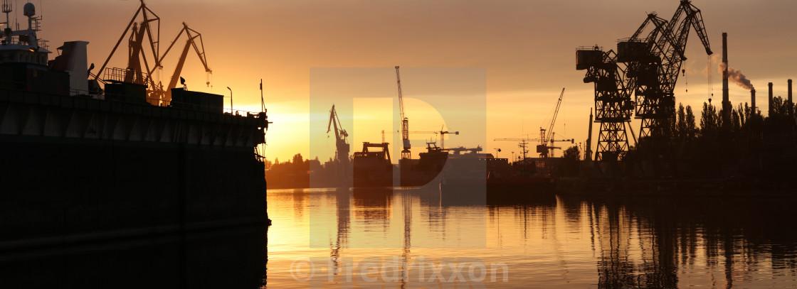 """Sunset panorama of shipyards in Gdansk, Poland."" stock image"