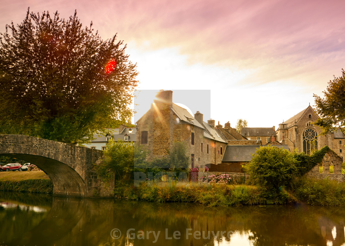 """Image of the canal and bridge at sunset at Lehon, Brittany France"" stock image"