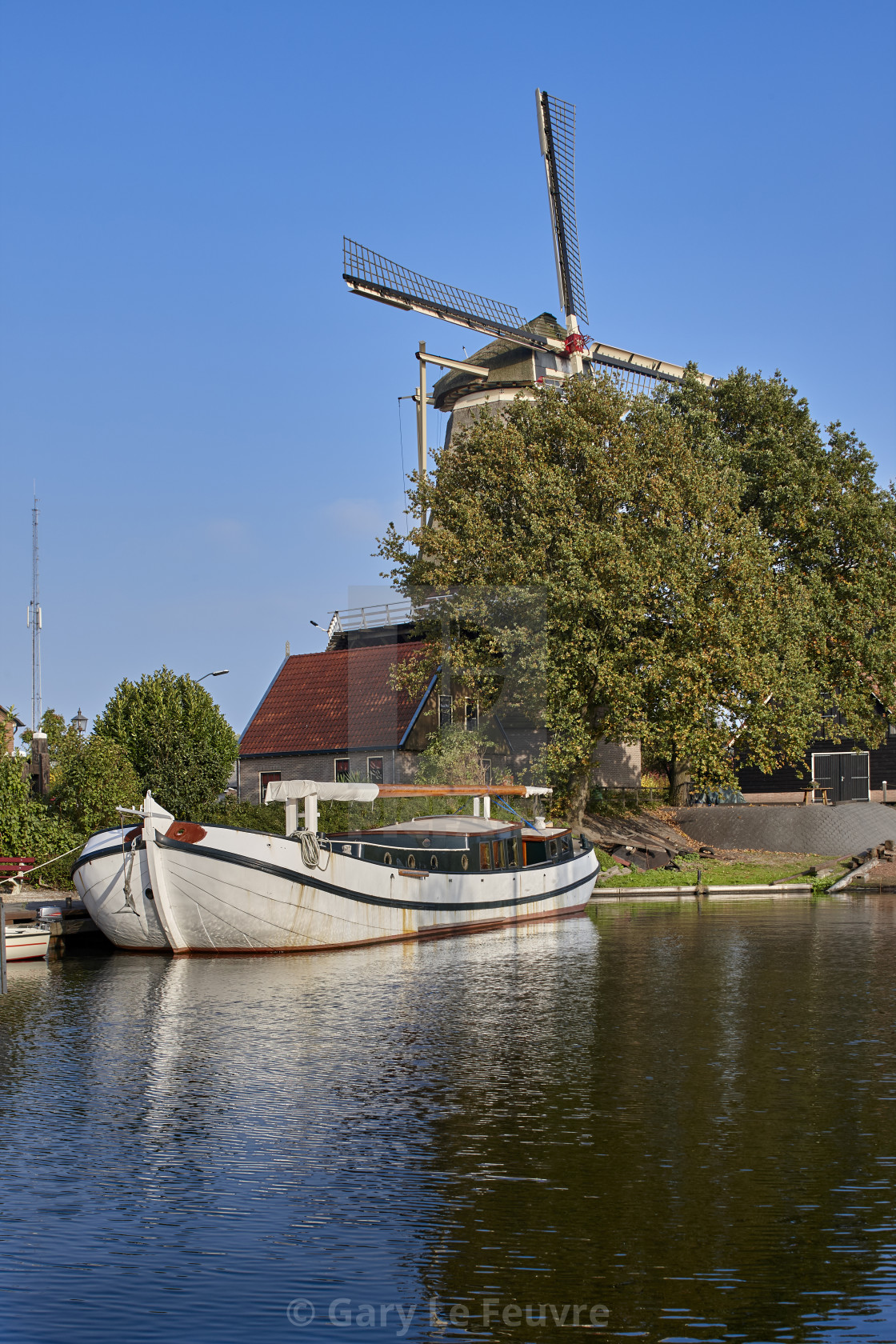 """Dutch Sailing Tjalk and Windmill"" stock image"