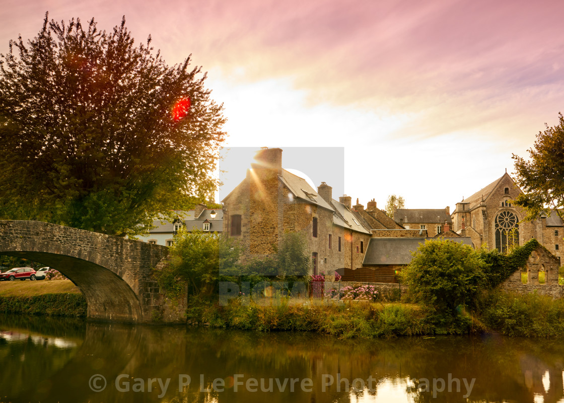 """""""Image of the canal and bridge at sunset at Lehon, Brittany France"""" stock image"""