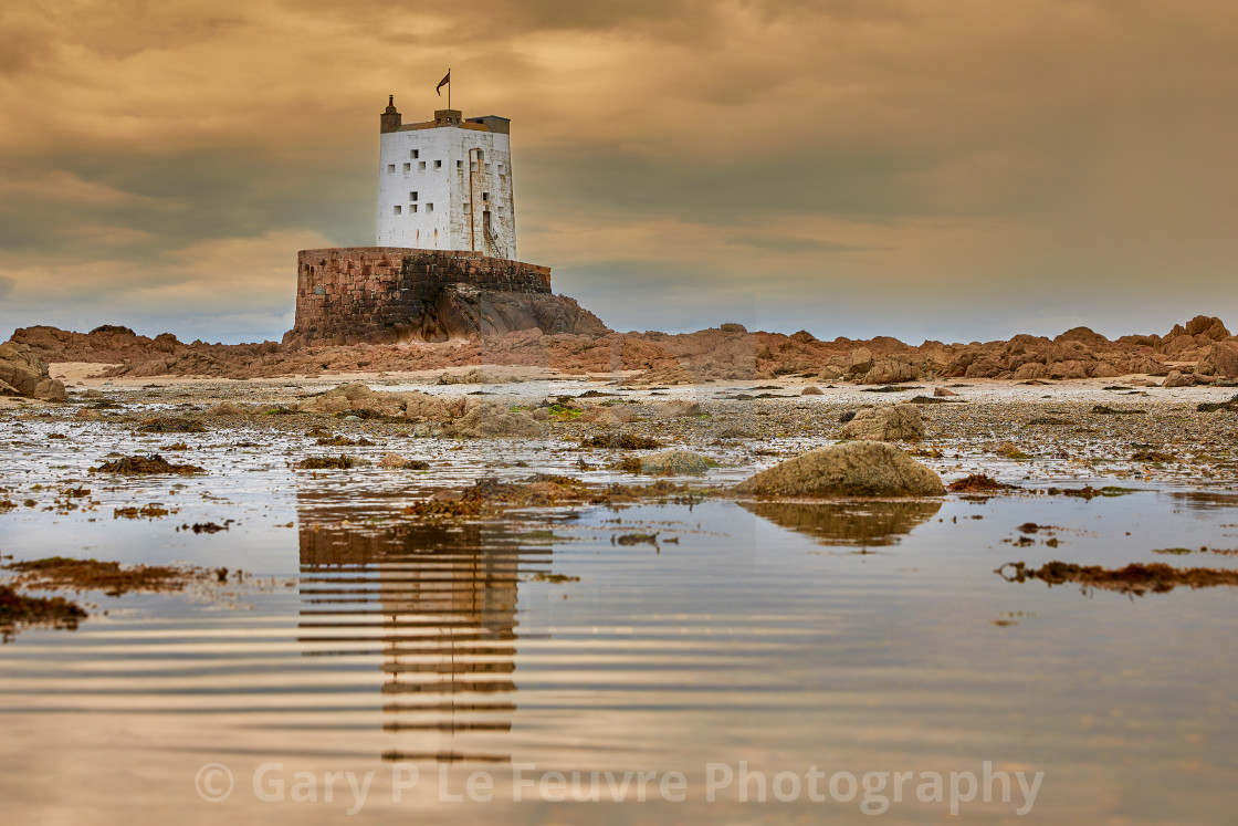 """""""Seymour Tower with cloudy sky and reflection in pool"""" stock image"""