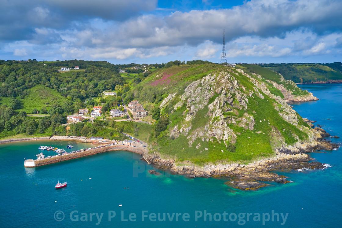 """Bonne Nuit Harbour and adjacent cliffs, Jersey"" stock image"