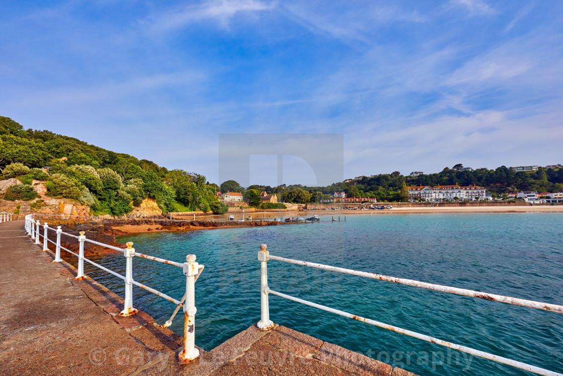 """Image of St Brelades Bay Pier at half tide"" stock image"