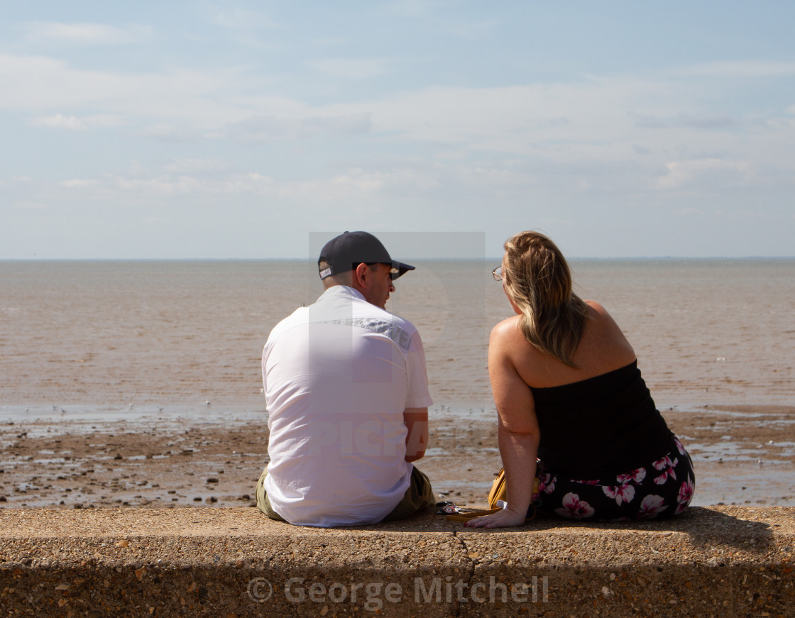 """""""Couple looking out to sea"""" stock image"""