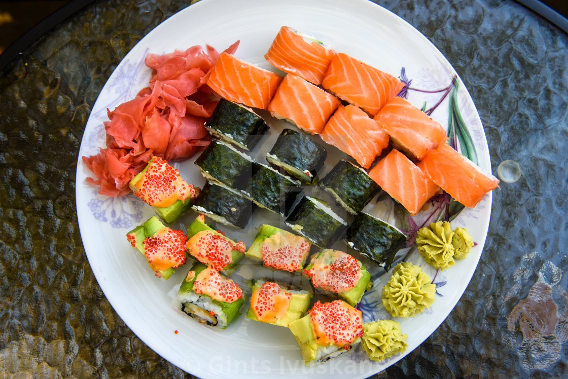 """Sushi set on plate ready to eat."" stock image"