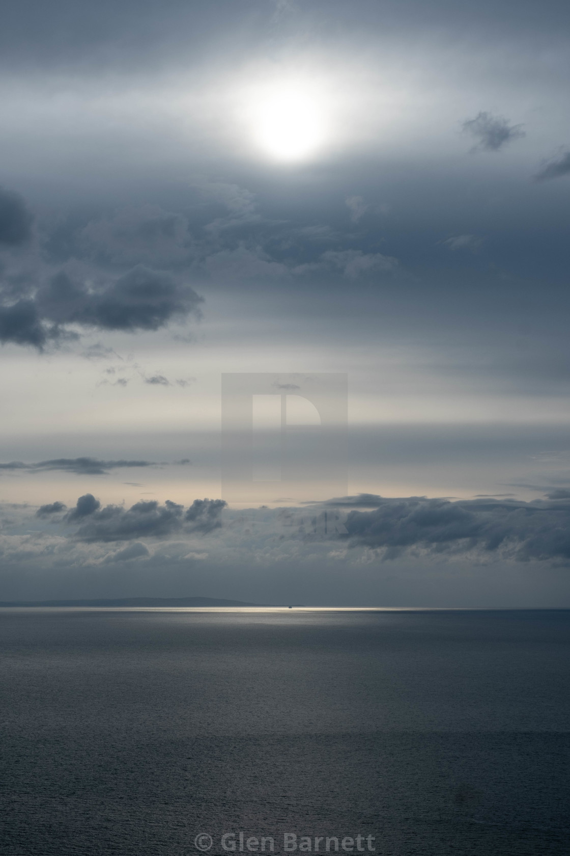 """""""Silver Sun, Sea and Clouds"""" stock image"""