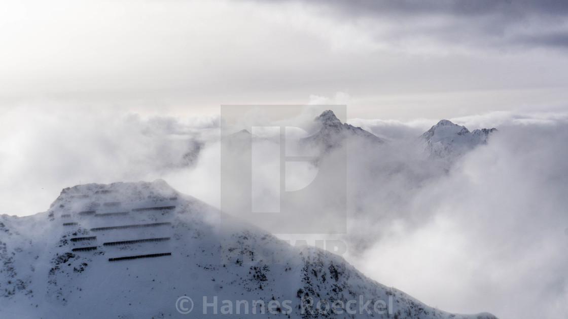 """""""Snowy mountains panorama and cloudy sky"""" stock image"""