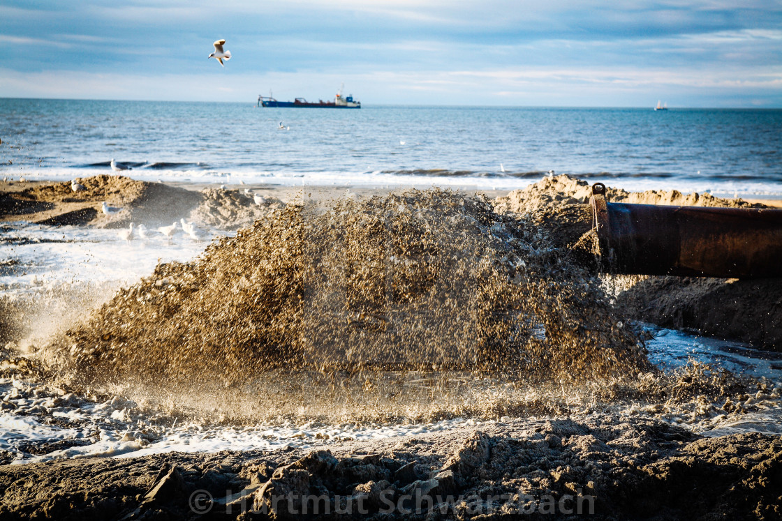 """""""Sand flushing with heavy equipment to secure the coast and the s"""" stock image"""
