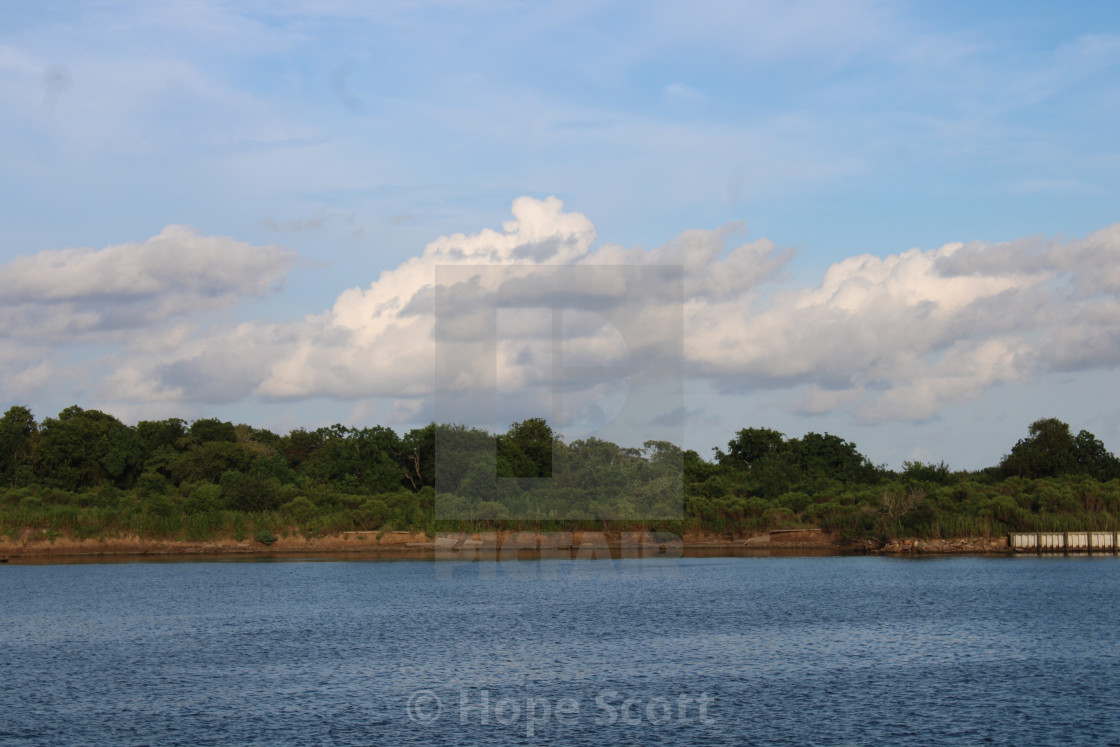 """Clouds over the water"" stock image"