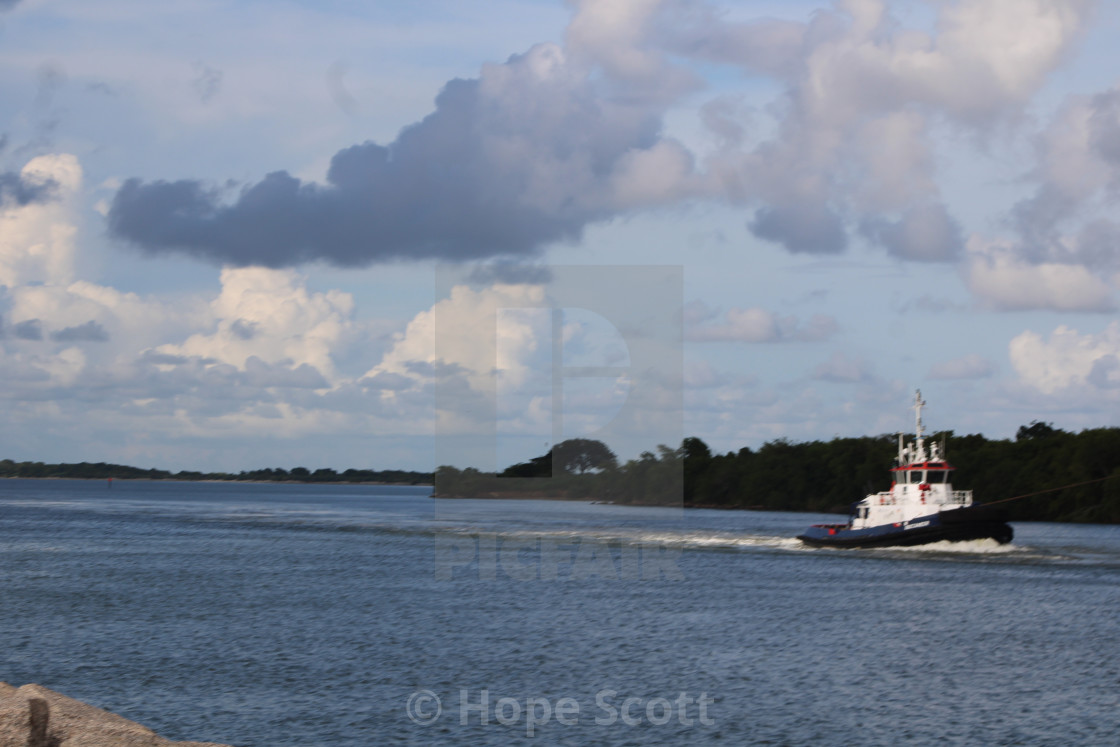 """Tug boat at work"" stock image"