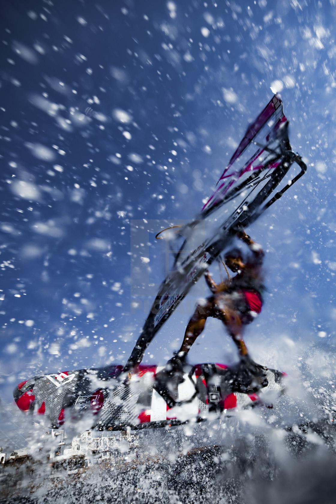 """Shooting a windsurfer in the desert"" stock image"