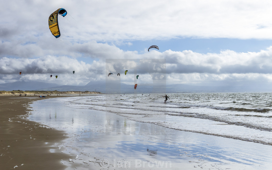 """Kitesurfers at Newborough"" stock image"