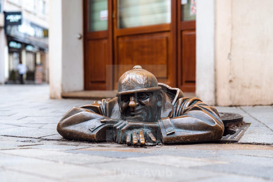 """Man at Work sculpture in Bratislava, Slovakia"" stock image"
