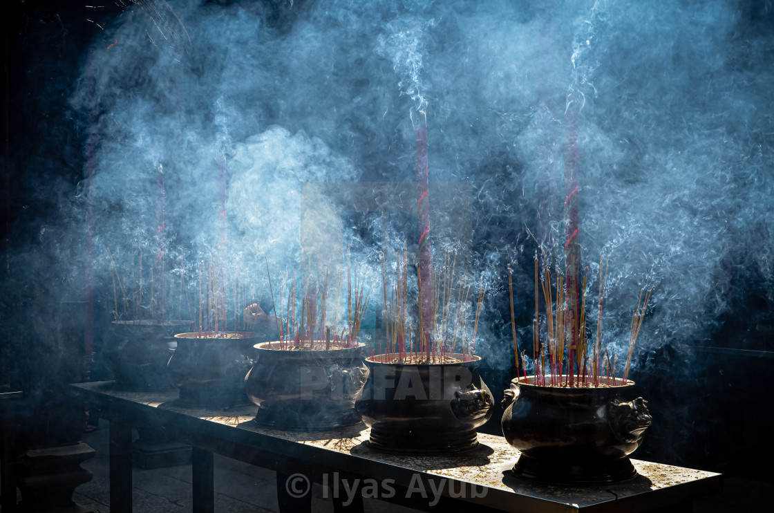 """""""Smoking conical incense coils and urns at Chua Thien Hau Temple in Cho Lon, Ho Chi Minh City, Vietnam."""" stock image"""