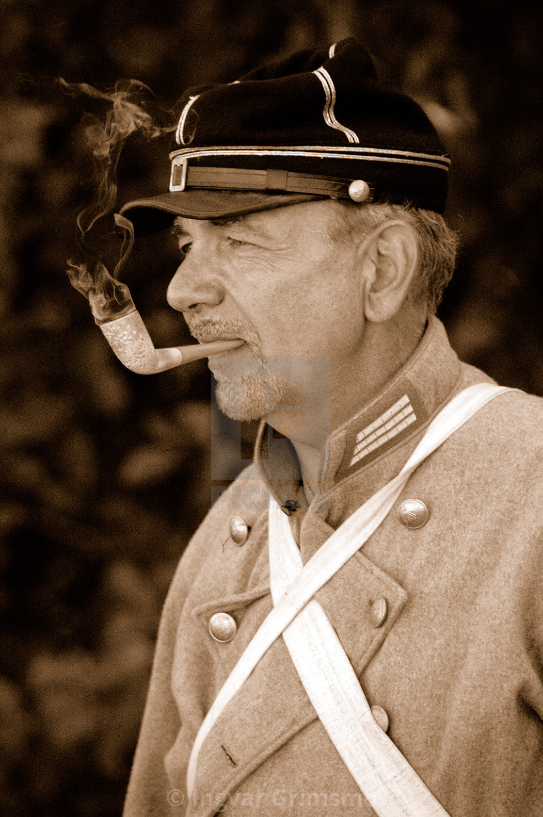 """Civil War Soldier Smoking a Pipe"" stock image"