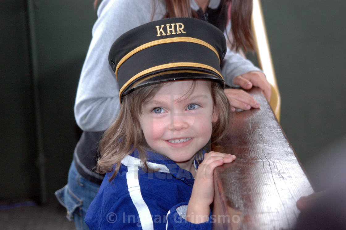 """""""Girl on train with a railroad hat"""" stock image"""