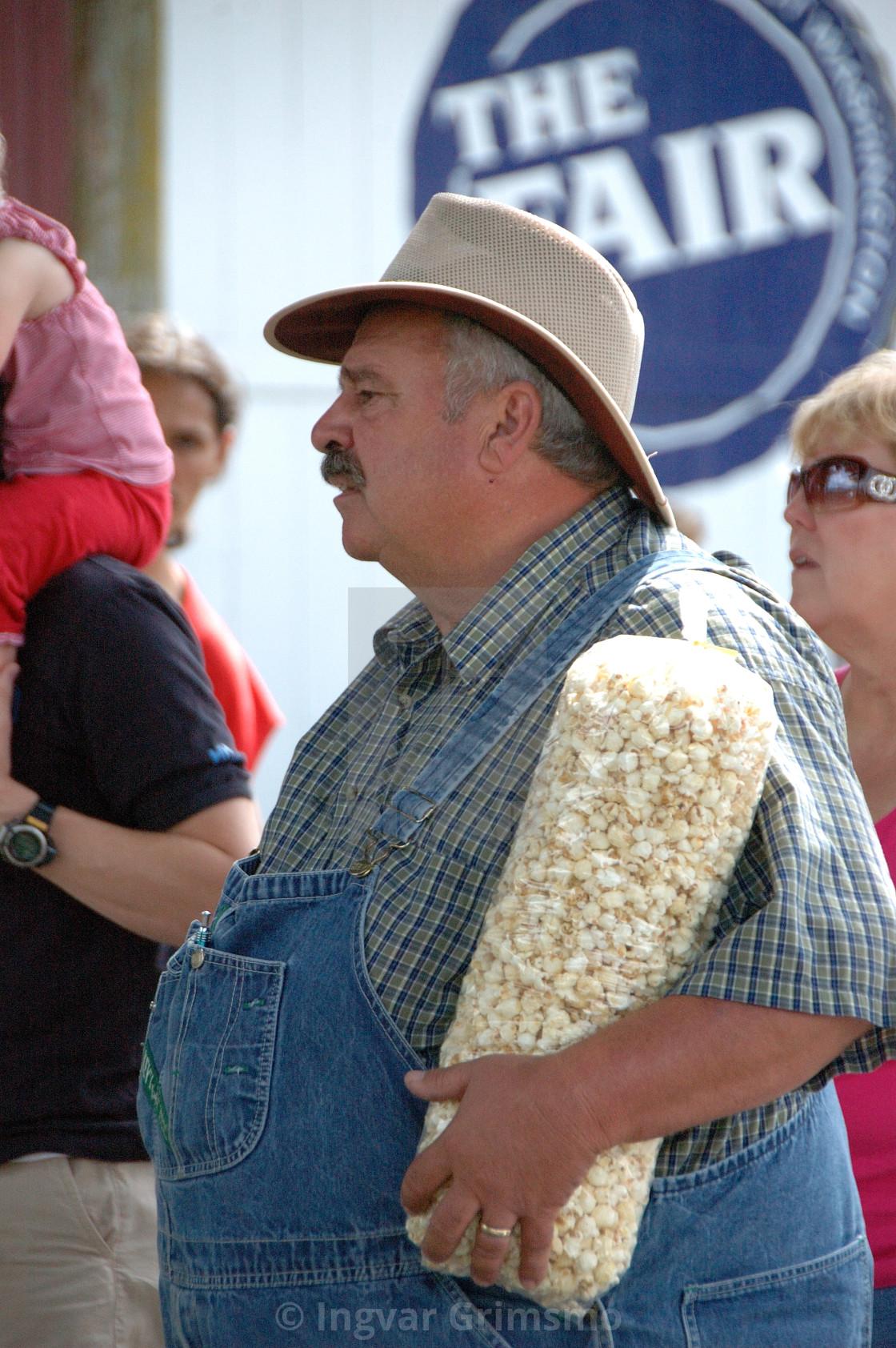 """County fair goer enjoying popcorn"" stock image"
