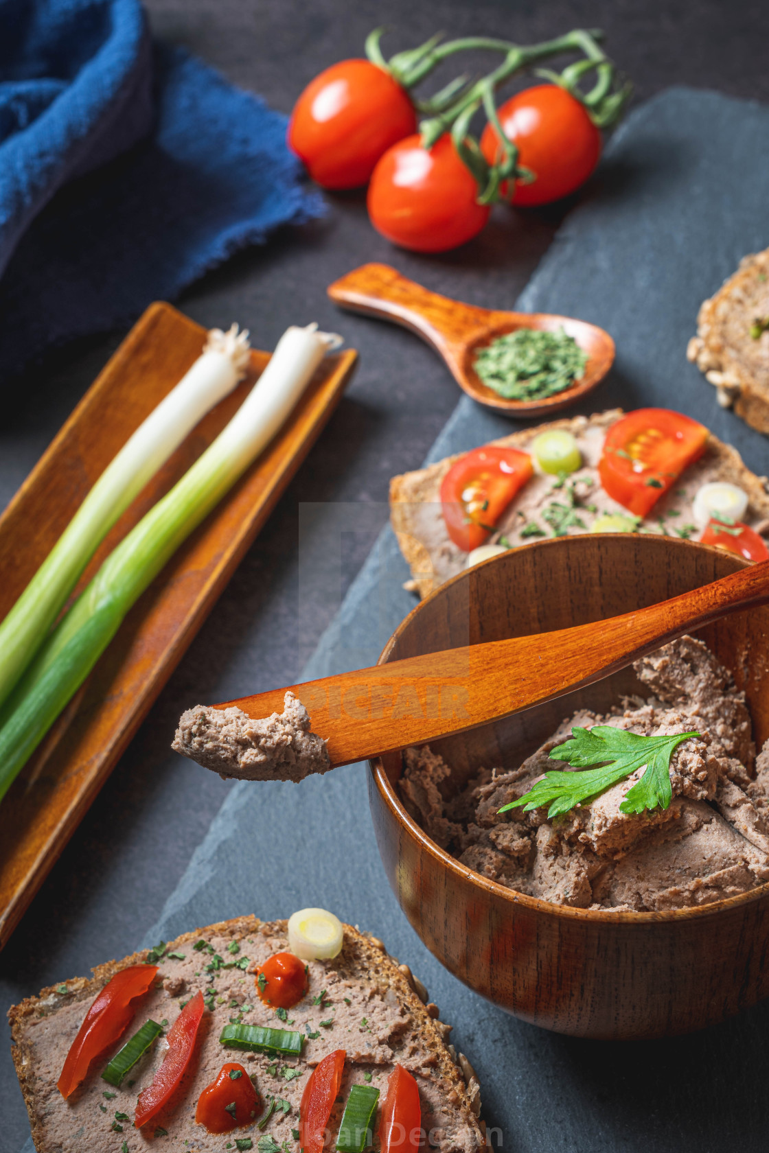 """""""Homemade Rustic Pate on Bitten Slice of Bread with Fresh Vegetables"""" stock image"""
