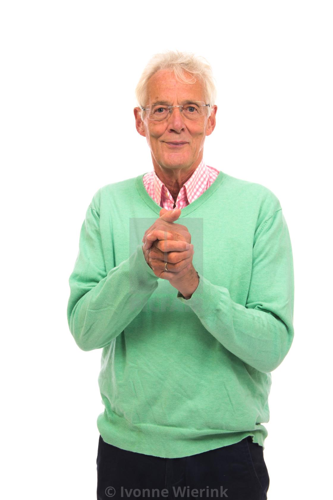 """Senior man in green jumper satisfied"" stock image"
