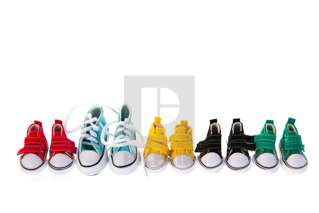 """Row colorful little sneakers"" stock image"