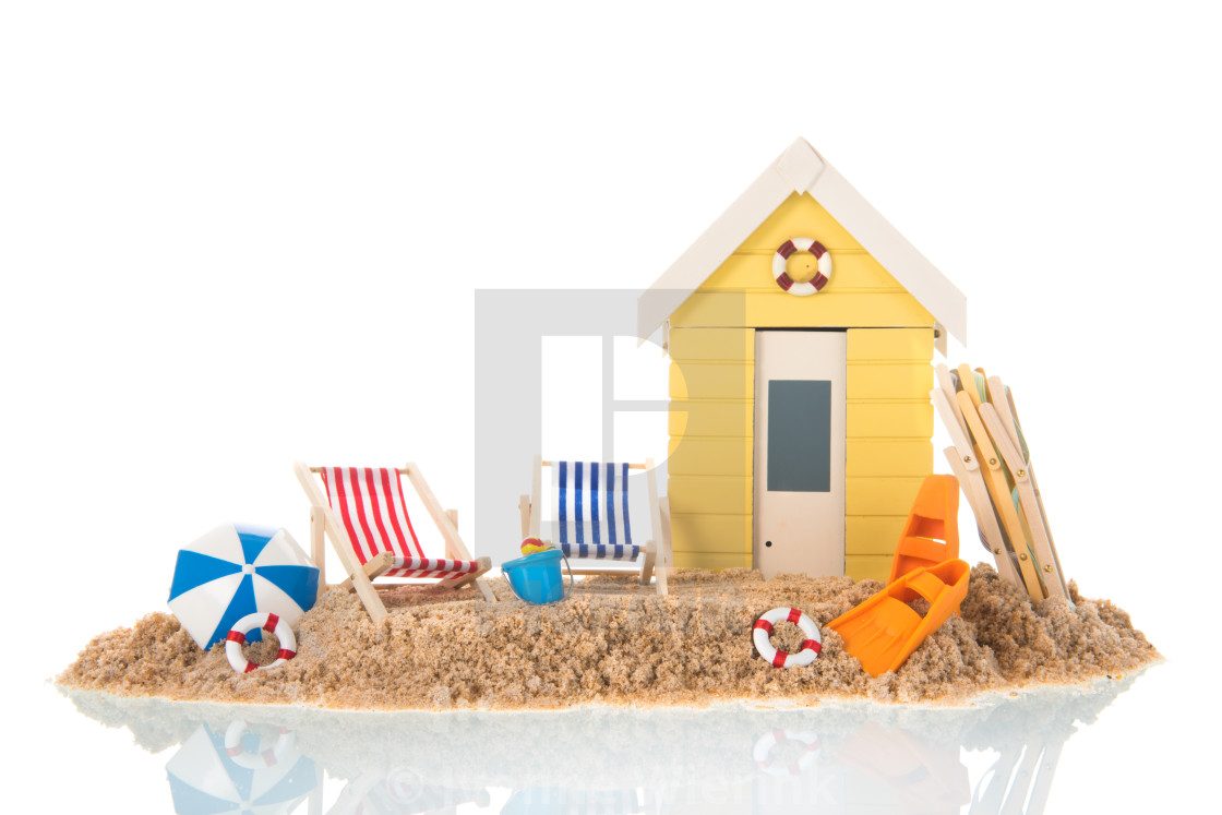 """Beach chairs and hut in sand"" stock image"