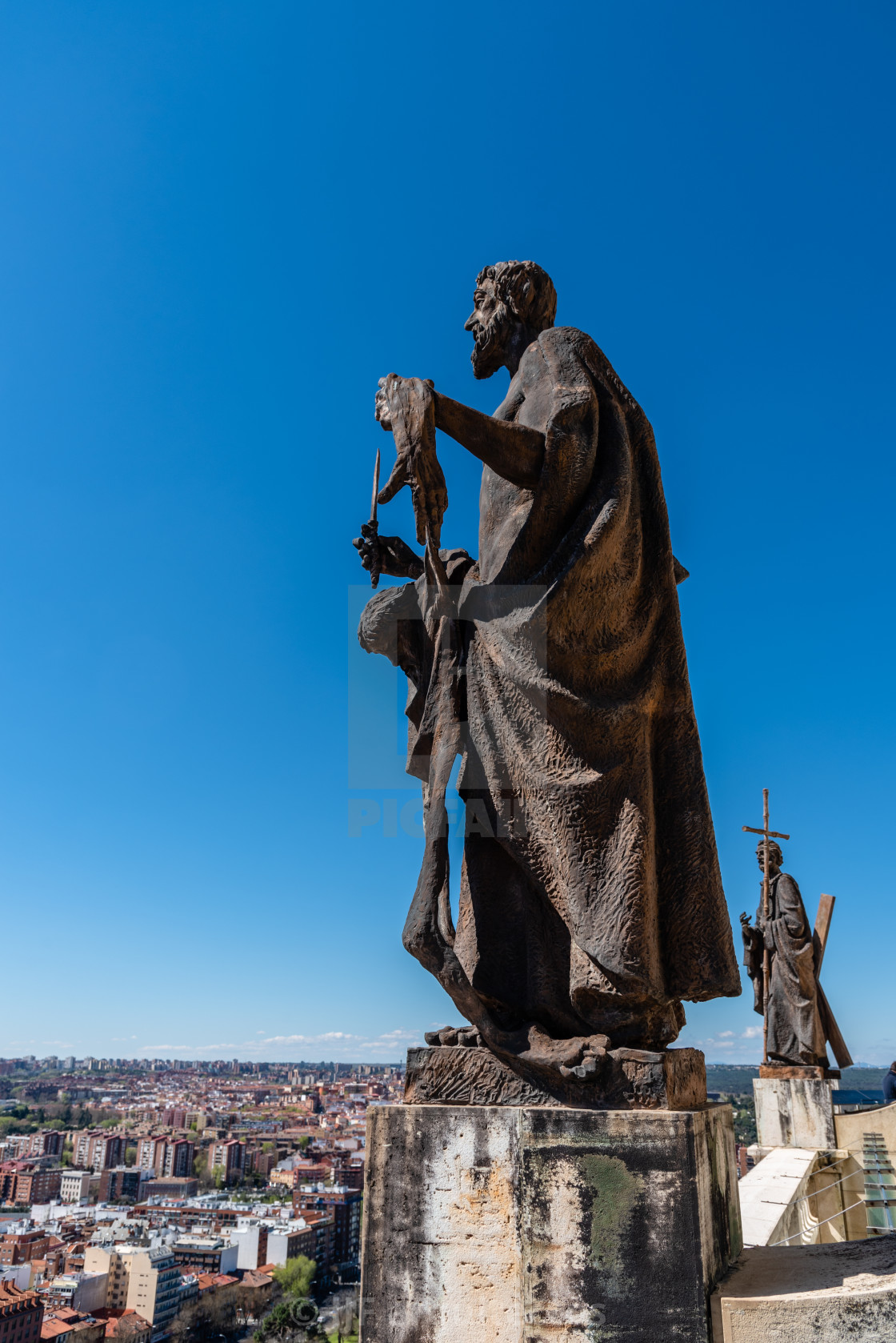"""""""Bronze sculpture of apostle at the rooftop of Almudena Catheral in Madrid"""" stock image"""