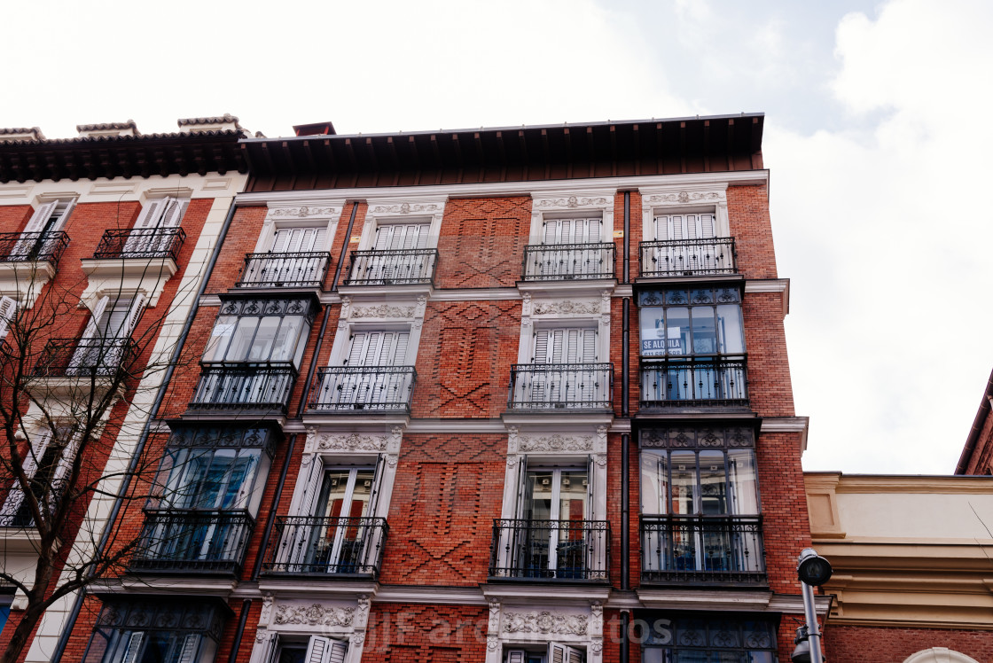 """""""Old luxury residential building with brick facade and iron balconies in Madrid"""" stock image"""