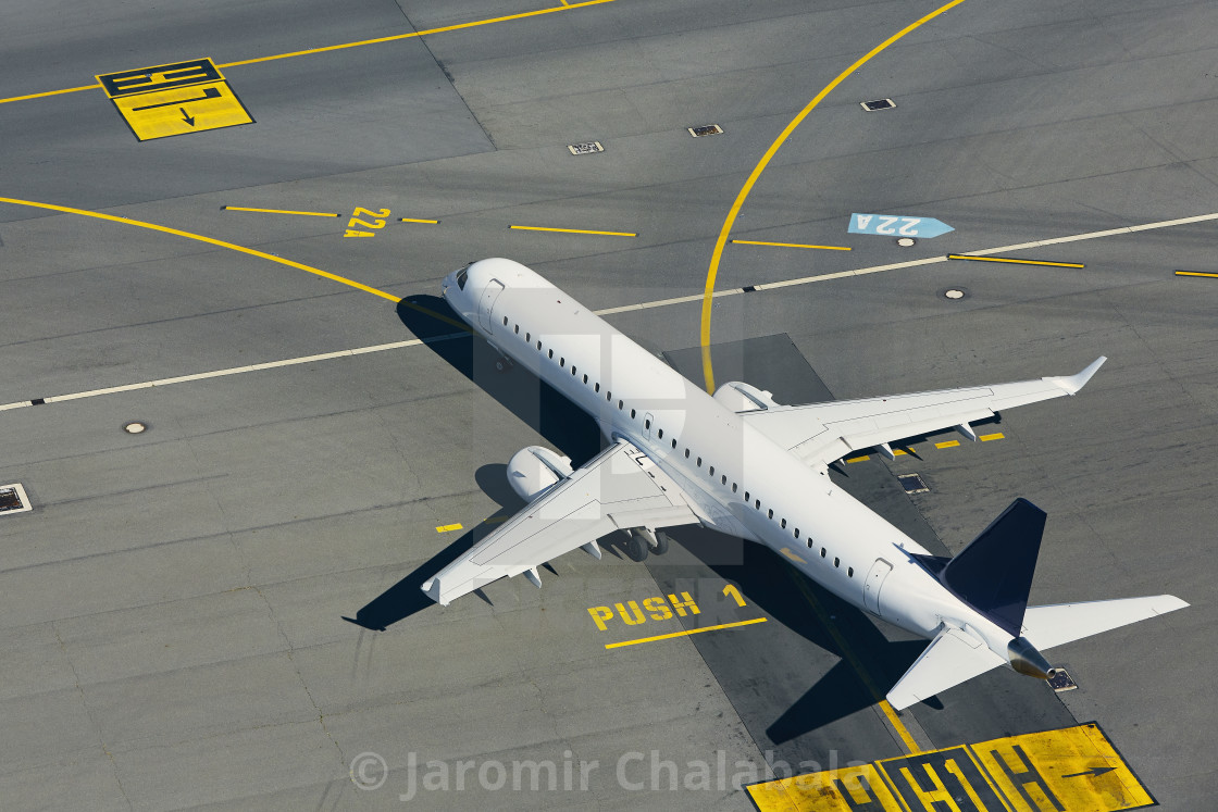 """Aerial view of airplane at airport"" stock image"