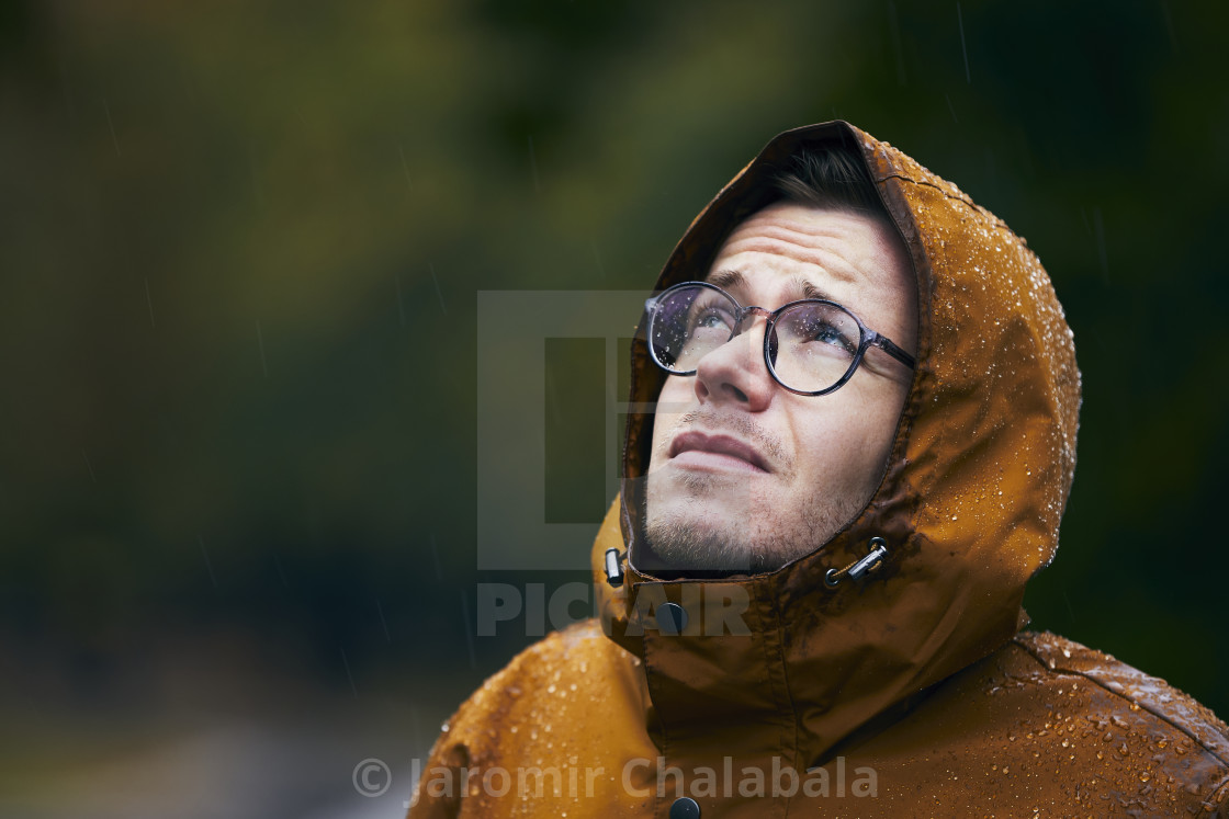 """Man in waterproof jacket during rain"" stock image"
