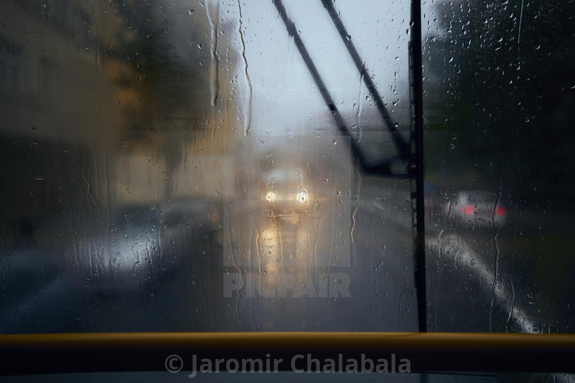 """Traffic in city street during heavy rain"" stock image"