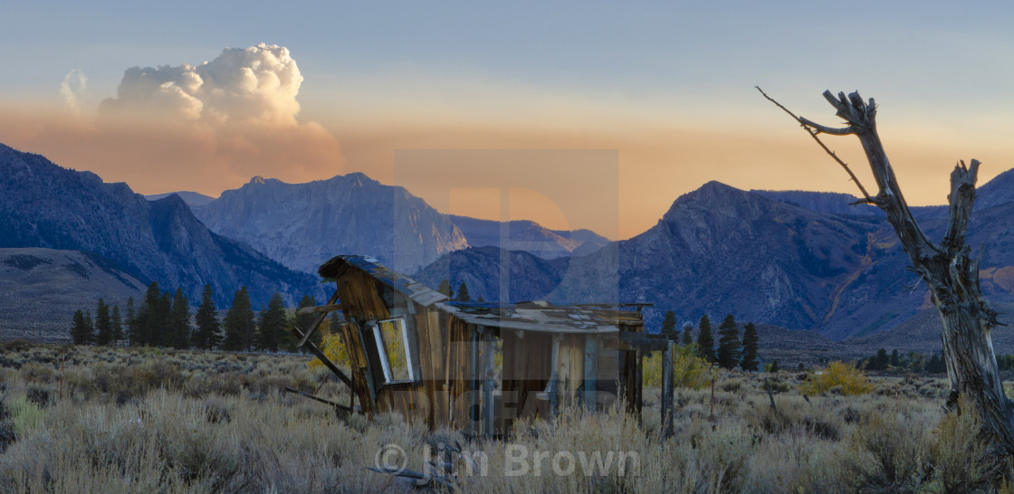 """Old cabin at sunset in the Eastern Sierras"" stock image"