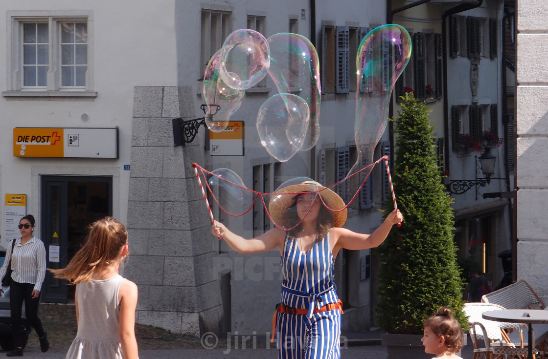 """""""A Woman with bubbles in the street"""" stock image"""