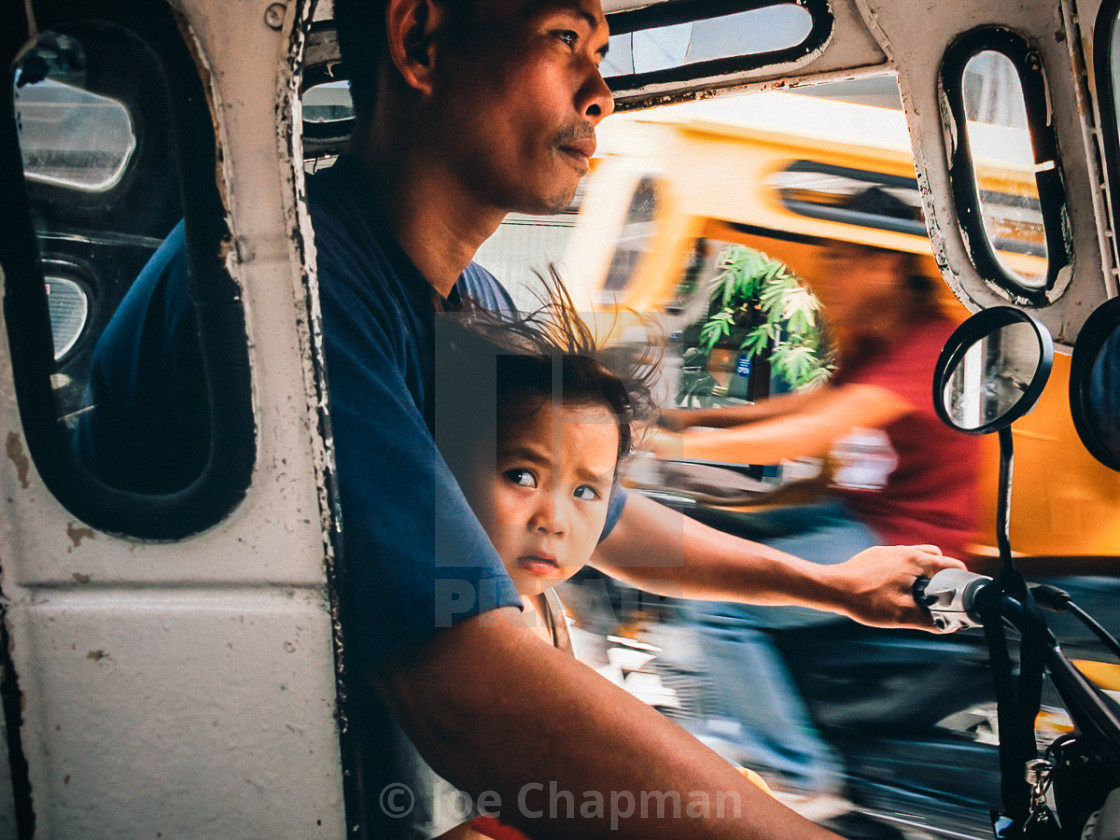 """""""Trike taxi driver with child"""" stock image"""