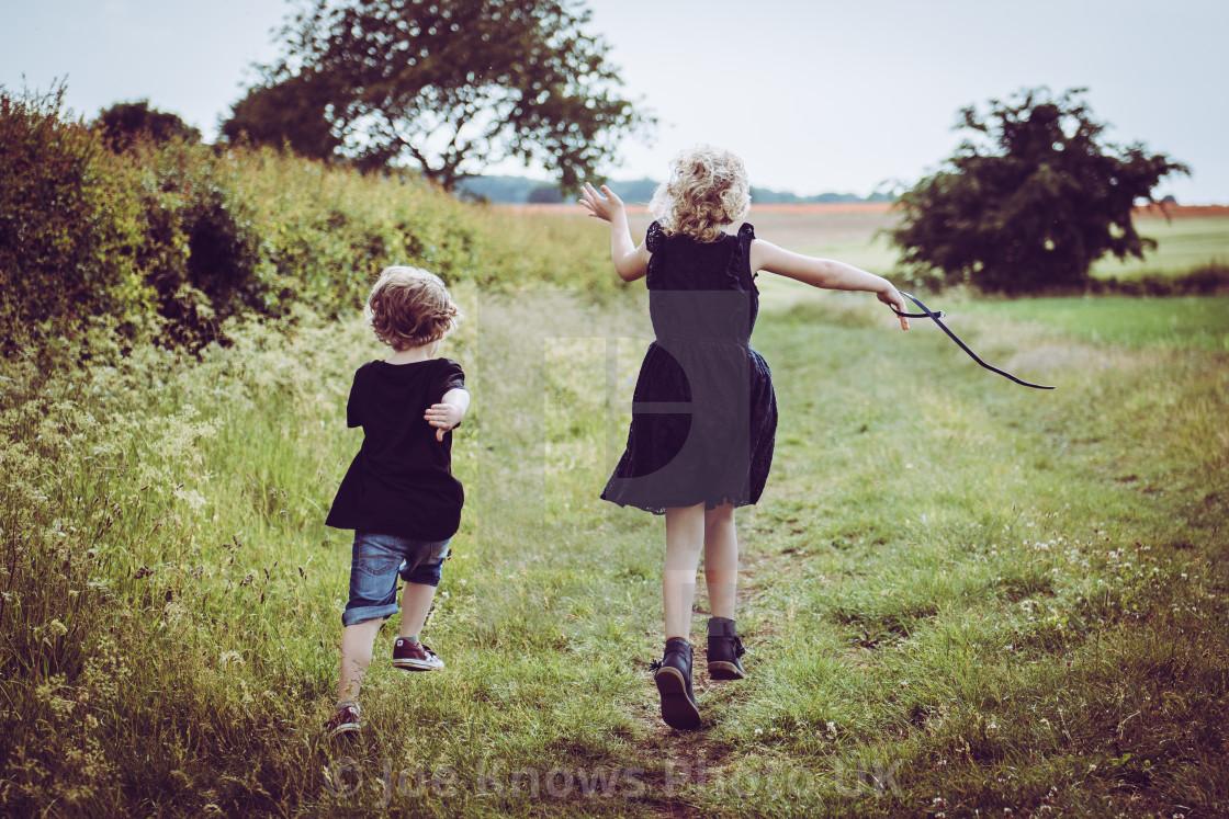 """Children running in field"" stock image"
